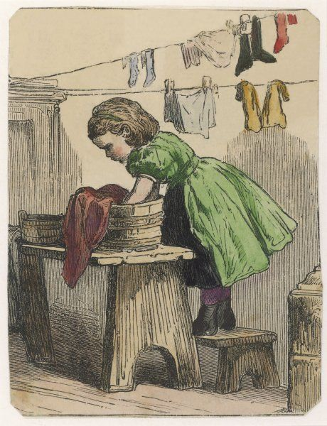 A little girl stands on a stool to wash clothes in a tub and hang them up to dry