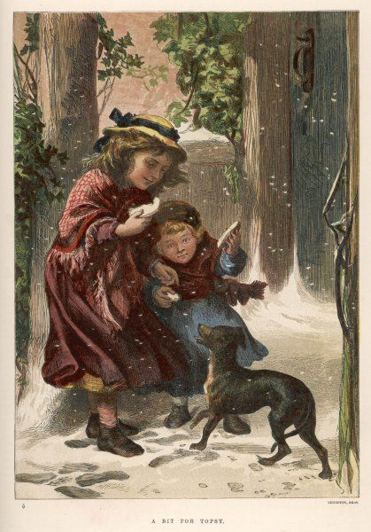 Two girls in the snow offer some bread to a hungry little dog