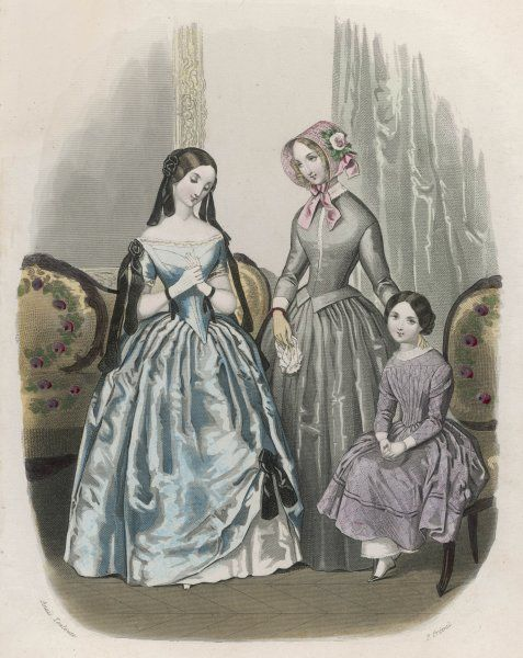 A girl wears a lilac diaper patterned dress with long sleeves with epaulettes / mancherons & vertical folds on the bodice. White pantalettes, cuffs & collar are worn