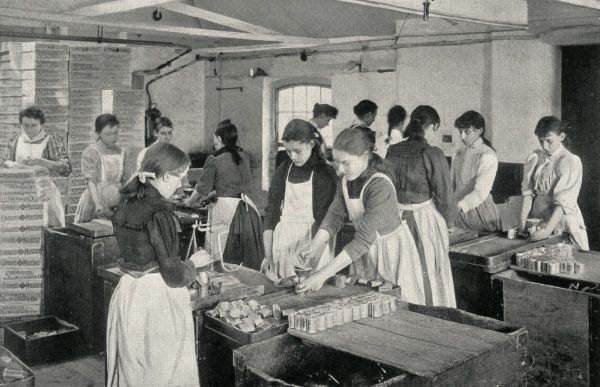 Girls at work filling penny tins of mustard at the firm of J Colman Ltd, Norwich, Norfolk