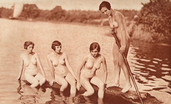 Four German girls float on a log Date: 1930