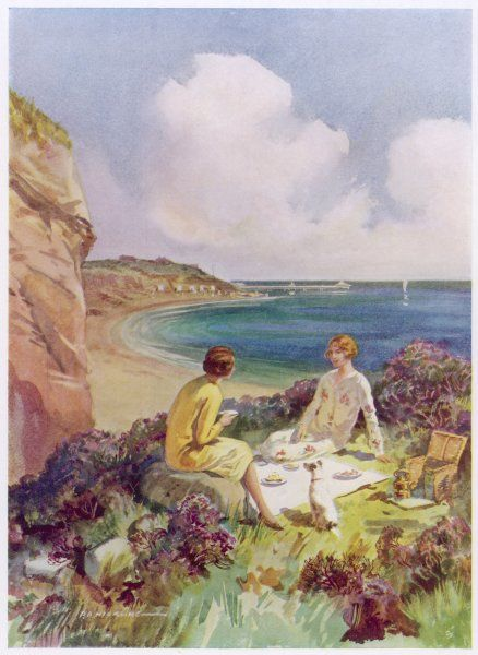 Two young women enjoy a splendid picnic by the sea
