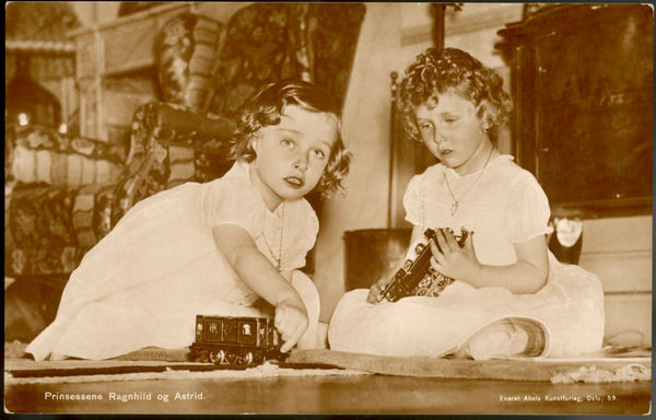 Two little girls (Princesses Astrid and Ragnhild of Norway) playing with their toy train set
