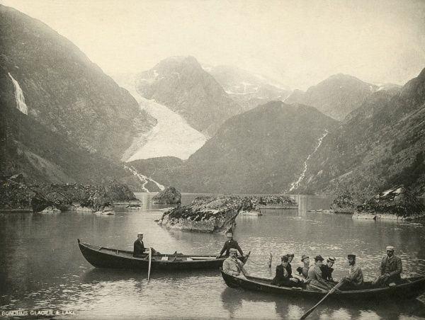 The Bondhus glacier seen from Bondhus fjord : sightseers are being rowed to the glacier for a closer look. Date: circa 1890