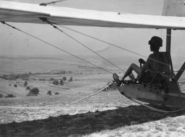 A young glider wearing a crash helmet, seen just before take- off. Date: 1930s