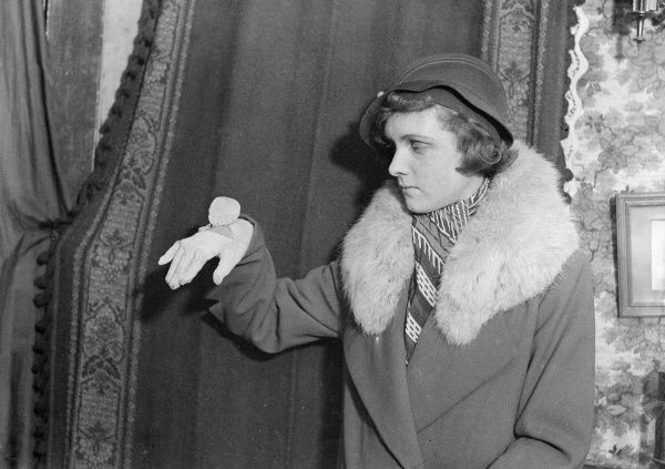 A fashionable young woman shows off her glove, which has a natty fitted wrist watch in it! Date: February 1933