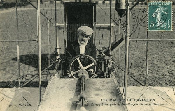 French aviator Jean Gobron in the pilot's seat ('poste de direction') of his Voisin biplane, one of many Voisins built in 1909 : Gobron flew his at Mourmelon and Reims. Date: 1909