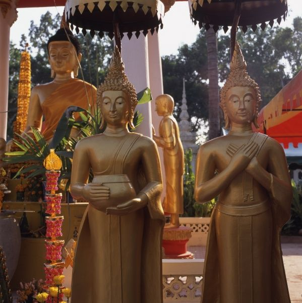 Golden statues of Buddhas and Bodhisattvas (enlightened beings) at Wat Si Saket (or Sisaketh), a Buddhist temple in Vientiane, Laos. Built in 1818 in Siamese style, it is probably the oldest temple still standing in Vientiane. Date: 2005