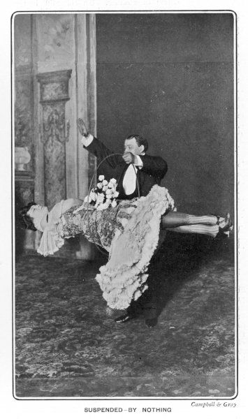 Horace Goldin suspends Miss Fransiola in mid air on stage at the Palace Theatre and passes a hoop around her body to show there are no hidden supports