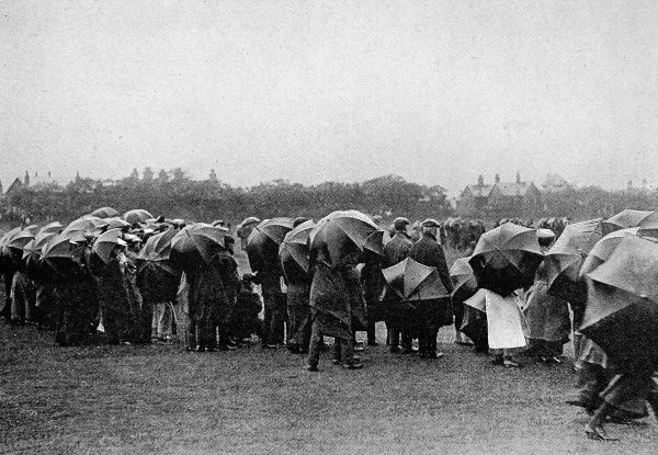 Photograph of the crowd at the Golf Amateur Championship at Hoylake, May 1906. Rain and strong winds combined to make conditions unpleasant for the final round of Mr. James Robb and Mr. C.C. Lingen