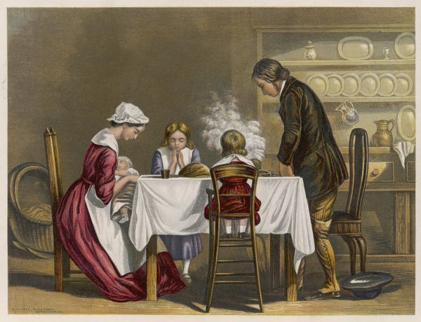 A countryman and his wife, with their three children, prepare to enjoy a meal