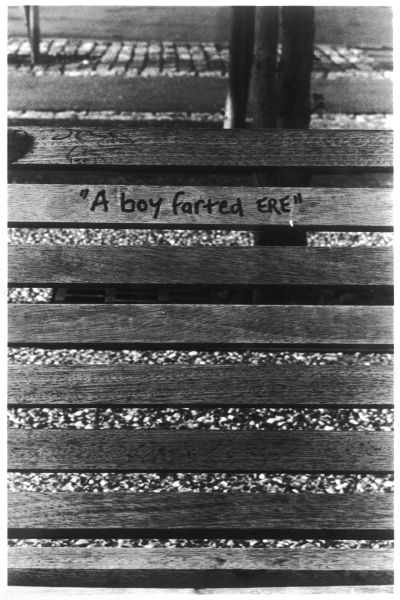 Graffiti on a park bench in Rotherhithe, London: 'A boy farted ERE&#39
