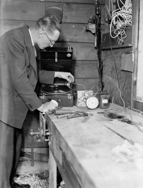 A young inventor with his 'gramophone alarm clock'! Date: early 1930s