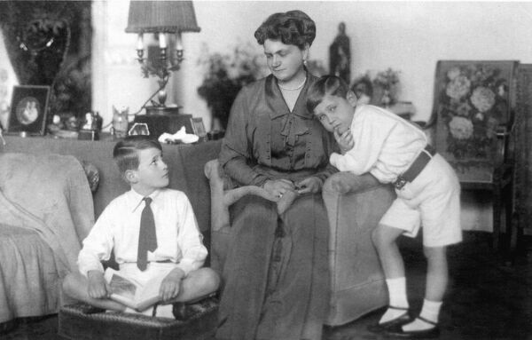 Grand Duchess Eleonore of Hesse, formerly Eleonore of Solms-Hohensolms-Lich (1871-1937), second wife of Grand Duke Ernst Ludwig of Hesse at home with her two sons, George Donatus (left) and Ludwig. This photograph was reproduced as a postcard for her charity