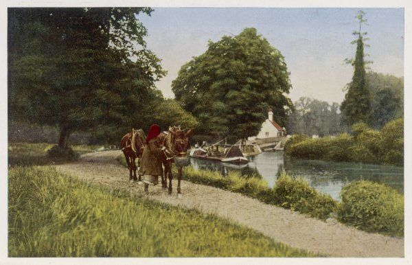 Two horses draw barges along the GRAND JUNCTION CANAL at Watford Locks. This photo is intended to encourage you to settle in London's Home Counties