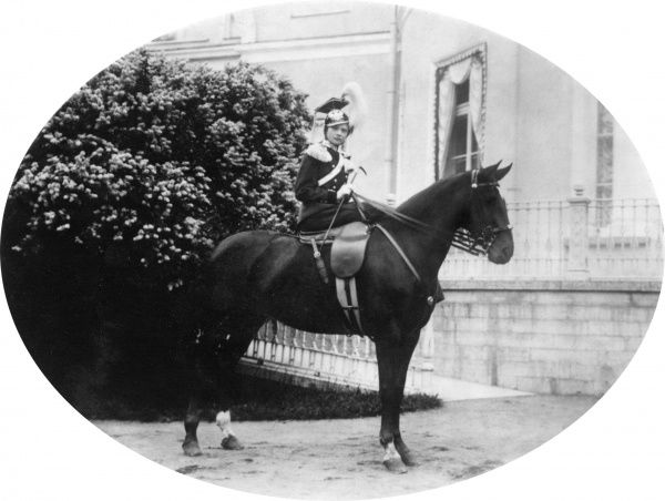 Grand Princess Tatiana Nikolaievna (1897-1918), daughter of Tsar Nicholas II and Tsaritsa Alexandra Feodorovna of Russia, granddaughter of Princess Alice, as Commander-in-Chief of the 8th Vosnesensky Lancers, on horseback, outside the Alexander
