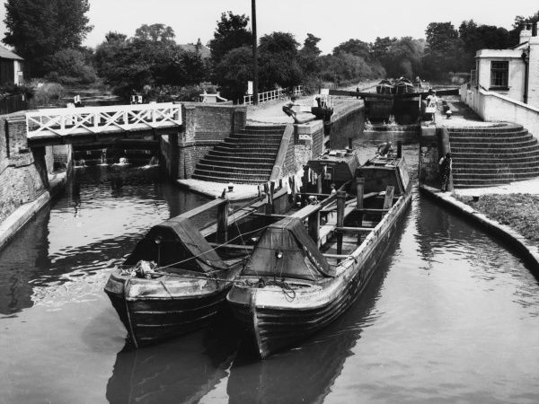 Narrow boats passing through the locks on the Grand Union Canal at Rickmansworth, in the Colne Valley, Hertfordshire, England