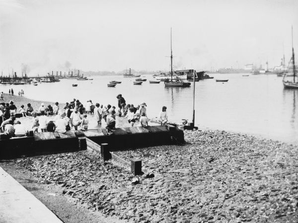 A Thameside paddling pool for children as they play on the banks of the River Thames at Gravesend, Kent, England