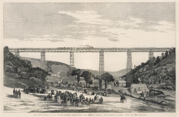 Victorian crowds gather and watch as a train passes along the Crumlin Viaduct in Wales, carrying the Newport, Abergavenny and Hereford Railway
