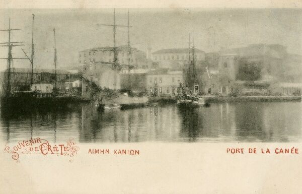 The Port of Chania - looking inland. A number of large sailing ships are moored against the quayside