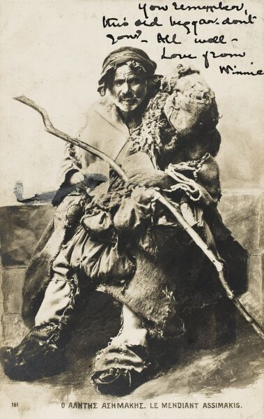 Well-known Greek beggar Assimakis, swathed in rags and holding a very large staff