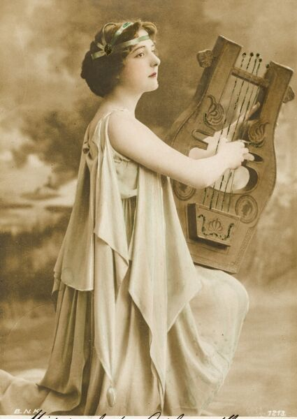 Lady in the costume of a classical Greek harp player