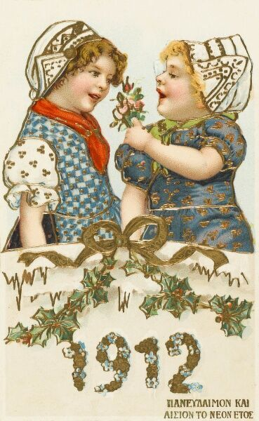 An interesting Greek New Years card, featuring two young Dutch girls, with Greek script