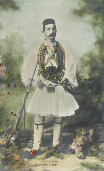 A Greek soldier in Traditional Costume. He is bristling with a wide variety of weaponry!