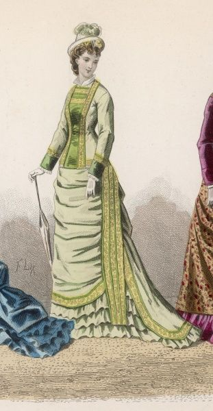 Vertical silhouette enhances by vertical trim on the cuirasse bodice and skirt. The front plastron is in the same shade as the cuffs. The skirt has a rounded train