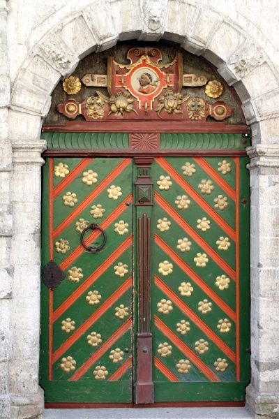 Green, gold and red decorated door on the House of the Brotherhood of the Blackheads in Tallinn, Estonia circa 2008