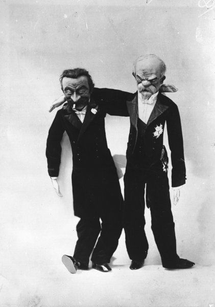 Grotesque dolls of French statesmen Aristide Briand (1862 - 1932) and Raymond Poincare (1860 - 1934)