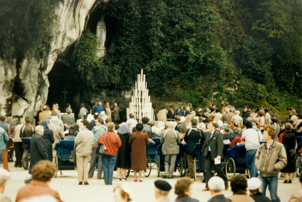 Pilgrims gather at the Grotto where Bernadette Soubirous met the Virgin Mary : probably no other riverside rock has attracted so many visitors !