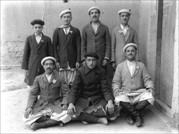 An unidentified group of seven Middle Eastern men pose for their photograph. Photograph by Ralph Ponsonby Watts