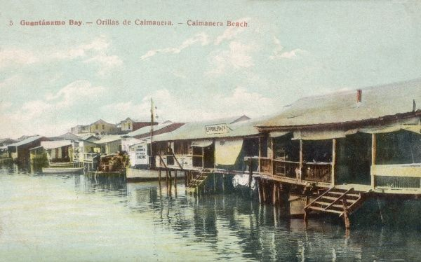 Guantanamo Bay, Cuba - Caimanera Beach Houses sitting on stilts at the waters edge. The United States assumed territorial control over Guantanamo Bay under the 1903 Cuban-American Treaty, which granted the United States a perpetual lease of the area