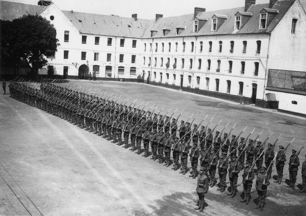 A Guard of Honour of the 1st Artists Rifles parade for inspection by King George V at the Ecole Militaire, Montreuil (Allied headquarters), northern France, during the First World War. Date: July 1917