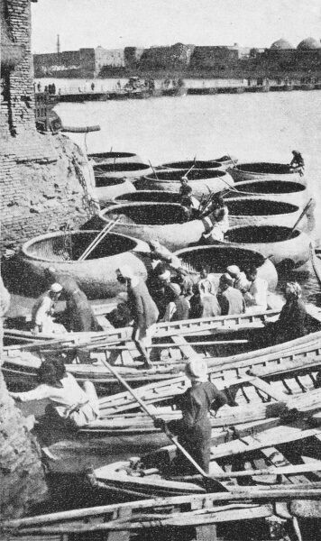 Gufa and Bellum boats awaiting hire on the River Tigris, which splits Baghdad, Iraq, in half