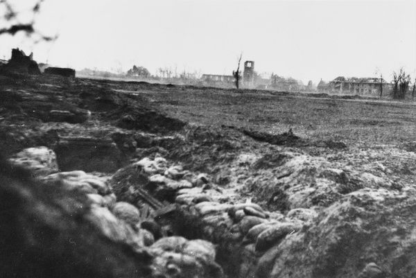 A view of the French village of Guinchy and the church in ruins, as seen from Old Boots trench