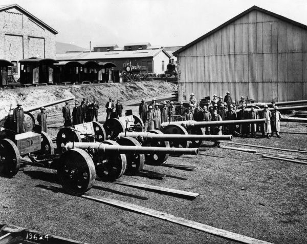 Handing over 4.7 inch (120 mm calibre) long-range guns to the army at Salt River Railway Works, near Cape Town, South Africa, during the First World War. The guns were used by South African forces against German forces in the South-West Africa Campaign