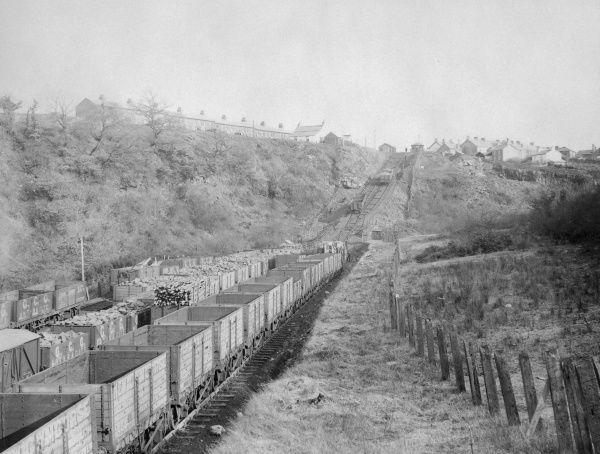 View of the Gwaun Cae Gurwen incline on the Great Western Railway near Ammanford, Carmarthenshire, Dyfed, South Wales, with a large number of trucks on the line. This photograph was taken by the official GWR photographer