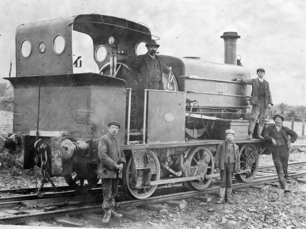Five railway workers with a Great Western Railway locomotive at Treffgarne, Nant Y Coy, Pembrokeshire, Dyfed, South Wales. They are navvies employed on the cutting of the embankment and tunnel, at the northern end of the workings