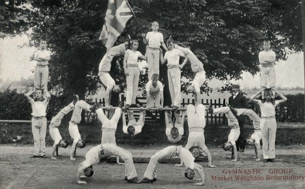A gymnastics display by inmates of the Yorkshire Roman Catholic Reformatory for Boys at Market Weighton, East Yorkshire, opened in 1856. Reformatories could house convicted juvenile offenders aged under 16 for a period of 2 to 5 years