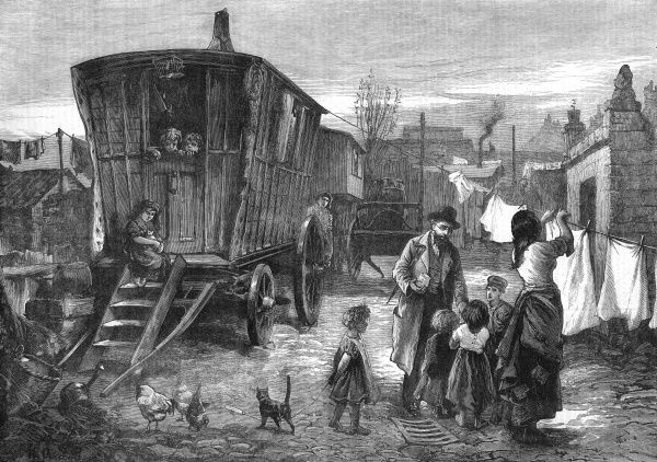 Sketches of gypsy life: an encampment near Latimer road, Notting Hill. Mr. George Smith, social reformer of Coalville, Leicester, can been seen conversing with a gypsy family in the fore ground. 1879