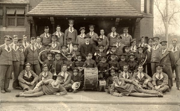 Soldiers at Budworth Hall military hospital on Chipping Ongar High Street are joined by the boys' band from the nearby Hackney Union cottage homes