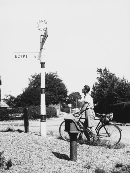 A cyclist near Burnham Beeches, Buckinghamshire, England, pauses to contemplate a strange sign reading 'Egypt half a mile'!