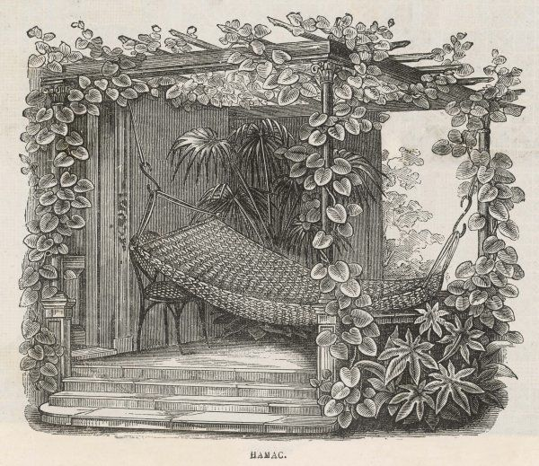 A hammock placed in a summer- house, surrounded by vegetation