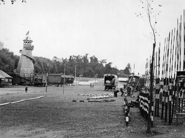 All thoughts are now on Bank Holiday and preparations are being made everywhere. Here we see men getting the fairground ready on Hampstead Heath, London. Date: early 1930s