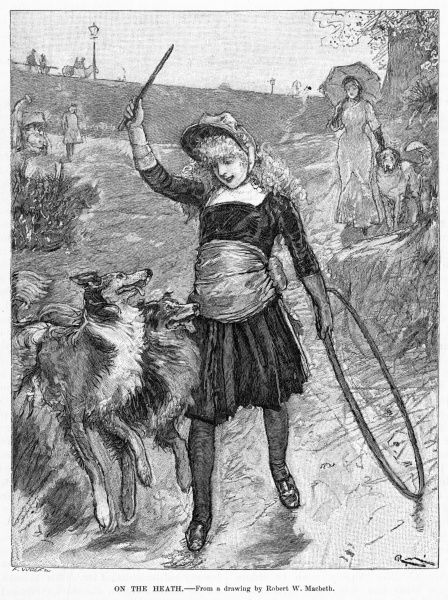 A girl with a hoop throws a stick for her hounds on the Heath