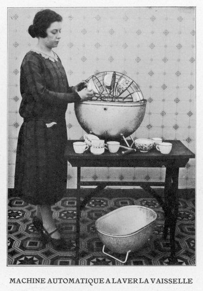 A French woman washing dishes using a hand-driven dish- washer