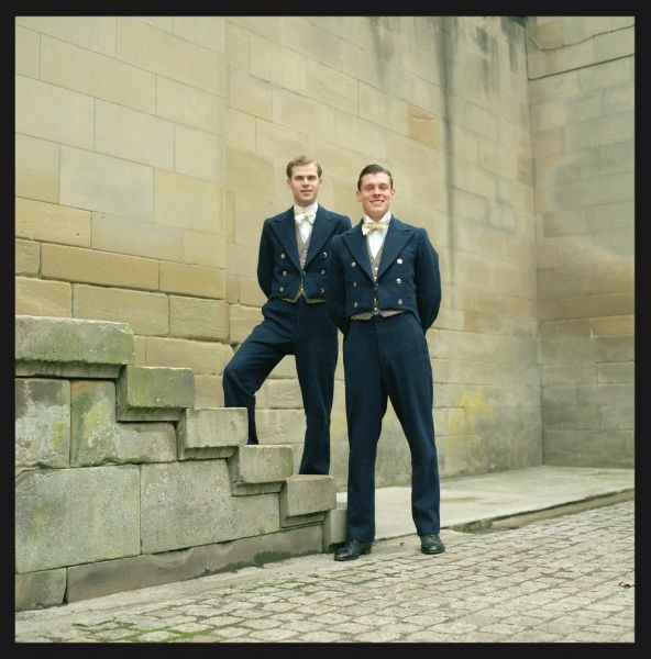 Two handsome Edwardian footmen in their livery
