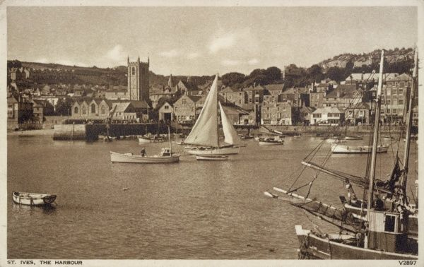 View of the Harbour at St Ives, Cornwall, with various boats and a church. Date: circa 1950